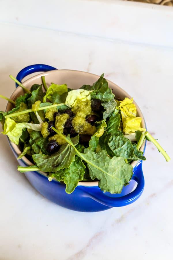 Baby kale and black bean salad