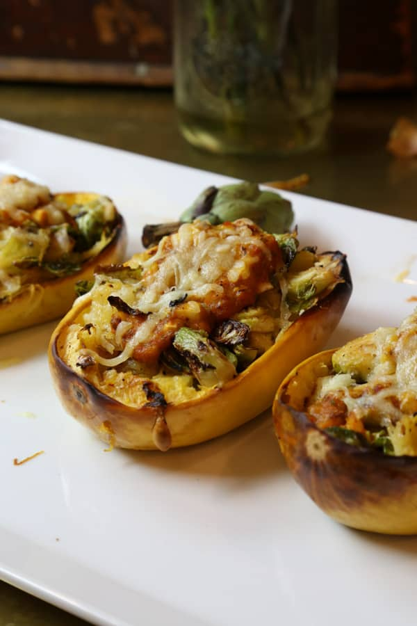 Stuffed Spaghetti Squash with Brussels Sprouts and Red Pepper Sauce